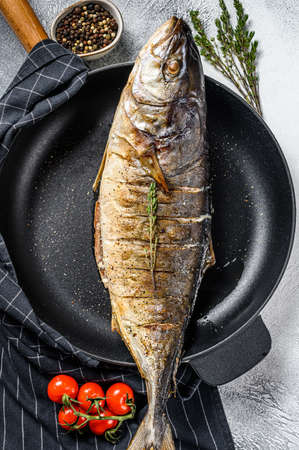 Grilled teriyaki flavored Yellowtail, Japanese amberjack in a pan. Gray background. Top view. 스톡 콘텐츠