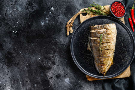Baked Yellowtail, Japanese amberjack fillet. Gray background. Top view. Copy space.