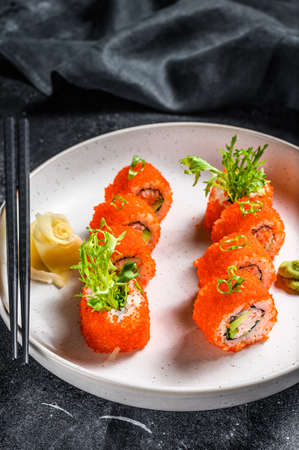California sushi roll with avocado and crab meat. Black background. Top view. Stock fotó