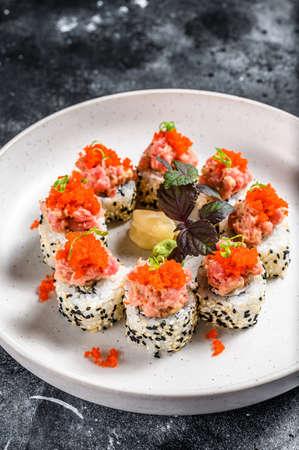 Sushi Maki roll with tuna, salmon and caviar. Black background. Top view. Stock fotó