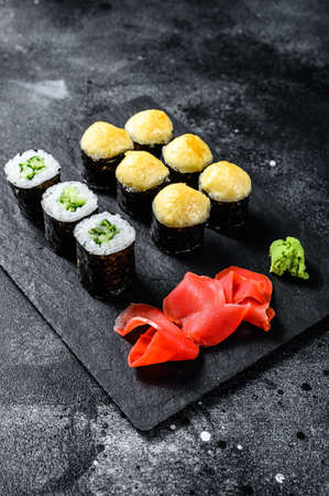 Various kinds of sushi served on black stone. Black background. Top view. Stock fotó - 157791177