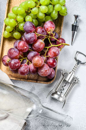 Concept of homemade winemaking. Green and red grapes. Wine background. Top view. 写真素材