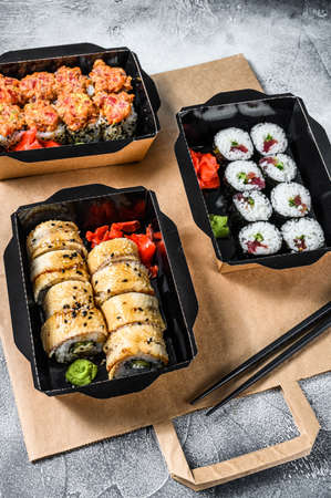 Delivery service Japanese food rolls in box. Gray background. Top view. Stock fotó - 157793621