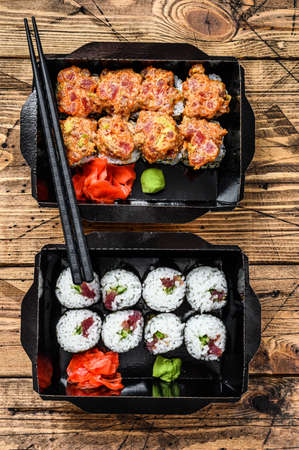 Japanese restaurant food in take away, set delivery box. Wooden background. Top view.