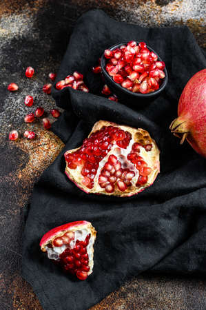 Ripe pomegranate. Organic fruit. Black background. Top view.