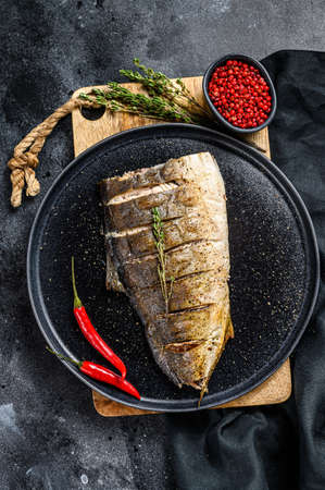Baked Yellowtail, Japanese amberjack fillet. Gray background. Top view. 스톡 콘텐츠