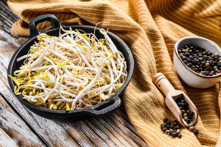Raw White Organic Bean Sprouts in a Bowl. White background. Top view. Stock Photo