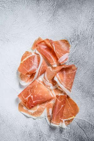 Italian prosciutto crudo, cured ham. White background. Top view Stock Photo