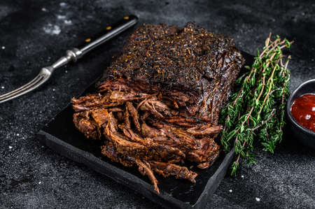 Texas Style BBQ Smoked Beef Brisket meat steak. Black background. Top view