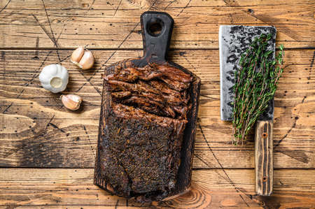 Homemade Smoked Barbecue Beef Brisket meat. wooden background. Top view