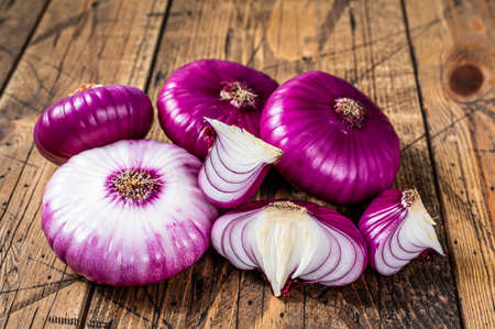 Sweet red onion on a wooden table. Wooden background. Top View
