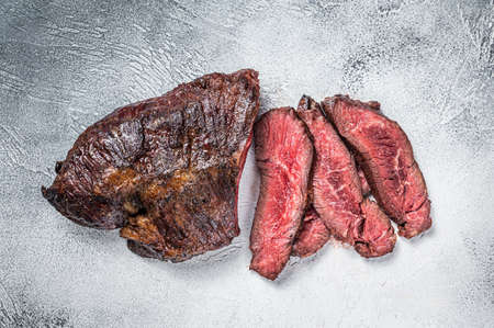 Roasted hanger or Onglet sliced beef meat steak on a table. White background. Top View Foto de archivo