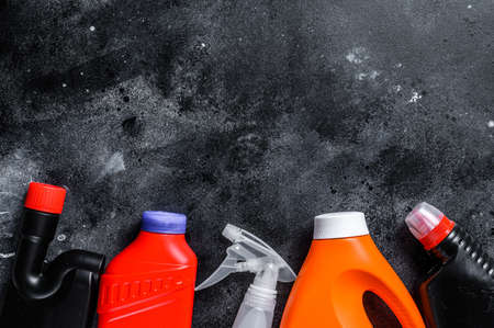 Home cleaning concept, housecleaning, hygiene, spring, chores, cleaning supplies. Black background. Top view. Copy space