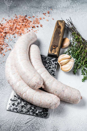 Bavarian traditional white sausages on a meat cleaver. White background. Top view 免版税图像 - 168547914