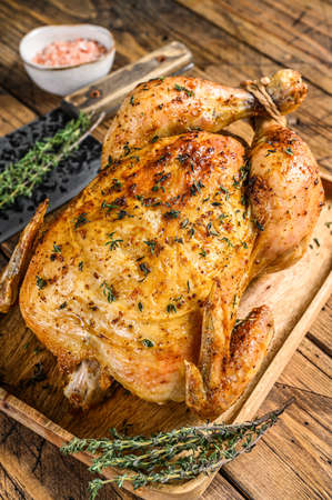Whole grilled chicken rotisserie. Wooden background. Top view