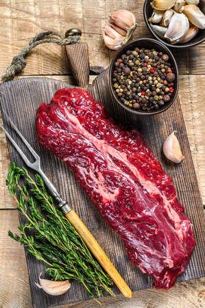 Butchers choice steak Onglet Hanging Tender beef meat. wooden background. Top view Standard-Bild