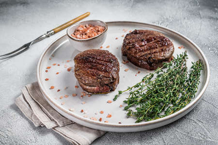 Grilled meat Fillet Mignon steaks from beef tenderloin. White background. Top view