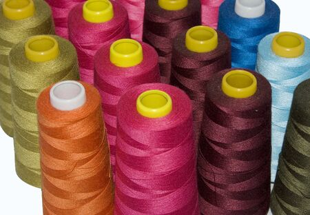 the textile industry: multi color spools with cotton for use in textile industry or fashion industry Stock Photo