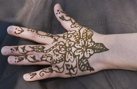 beautiful henna tatoe on a woman hand photo