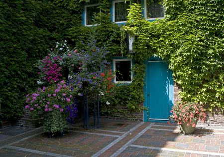 beautiful flowers and a blue door in a place in Germany, Kevelaer photo