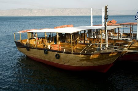 boat on the lake of galilee photo