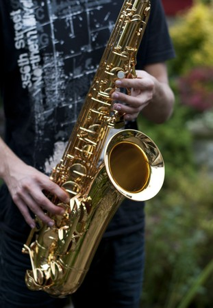 man playing on the sax photo