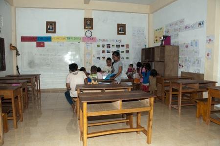 PETAK - 3 April 2011:children in old classroom getting education on April 3, 2011 in Petak, Bali Indonesia