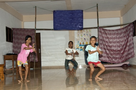 PETAK - 3 April 2011: Children dancing on stage for class and public on April 3, 2011 in Petak, Bali Indonesia