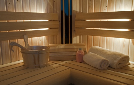 sauna interior with bucket and towel Stock Photo