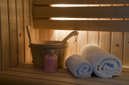 sauna interior with light and towel and scrub Stock Photo