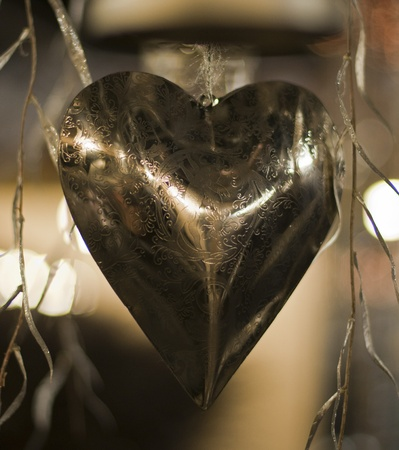 decoration from a metal hart with reflection photo
