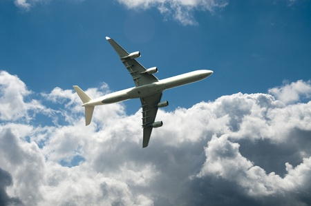 fly away with the plane in blue sky