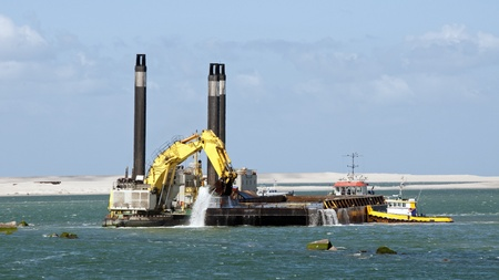 dredger ship working at the new harbour Europoort in Holland
