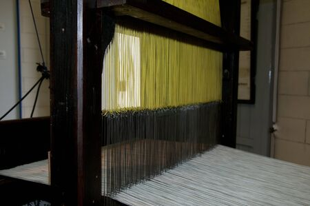 yellow and white cotton in a old loom Stock Photo - 11542255