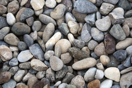 grid gravel background with different shapes of rocks photo
