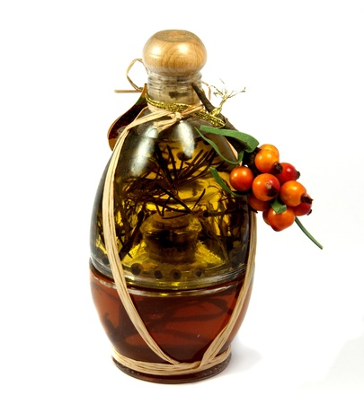 herb vinegar with orange decoration grapes photo