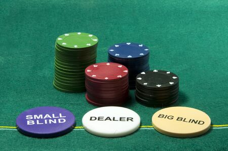 poker chips and the dealer small blind and the bigblind photo