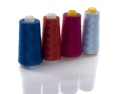 cotton in different collors for sewing machine photo