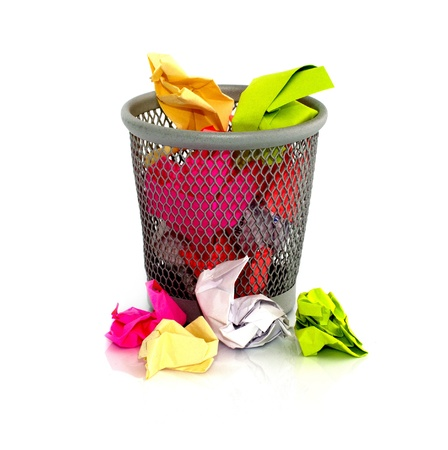 colored paper in  waste basket on isolated white photo