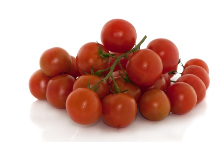 isolated fesh red cherry tomatoes  photo