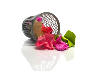 colored paper in waste basket as trash