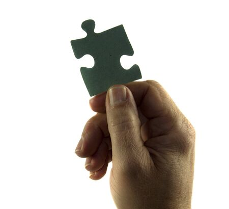 framed picture: hand holding puzzle