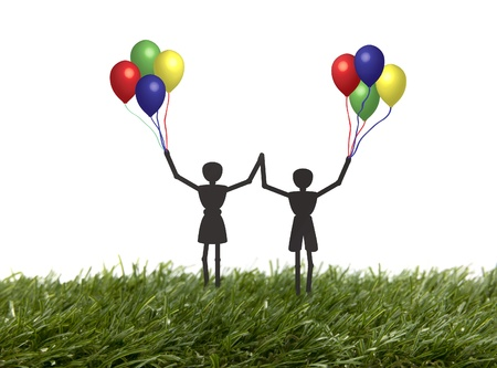 children happy playing with balloons outside in the grass Stock Photo - 13107926