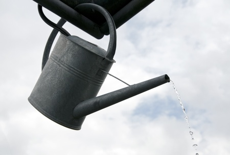 galvanized: metal watering can flowing water