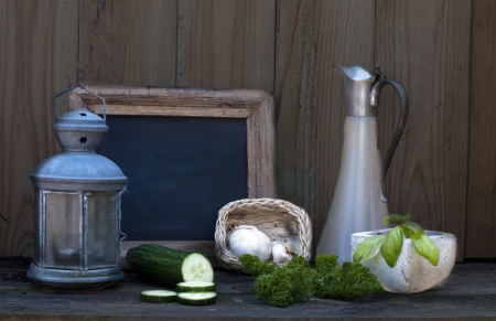 still life with light and school board garlic and cucumber photo