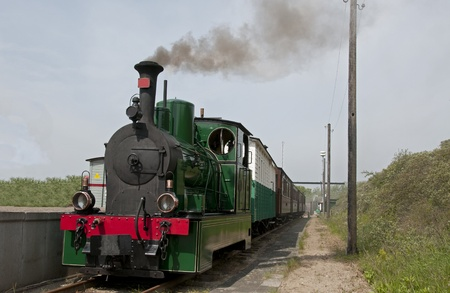 old green steam train in Holland photo