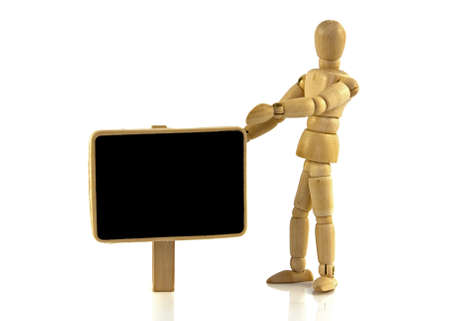 wooden puppet with empty blackboard photo