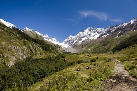 snow on the mountains in summer in Switzerland on the Flazeralps photo