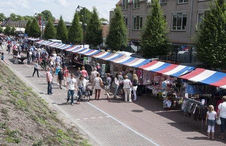 MIDDELHARNIS,HOLLAND - JULI 20  Unidentified people shopping on the dutch market,on April 11, 2011 in Middelharnis, Holland  This market is the biggest market in this place and hold once a year in Juli