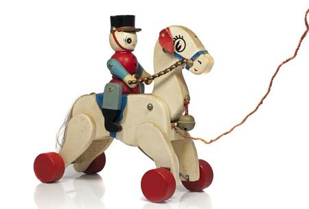 muneca vintage: jugar a caballo con un soldado de madera